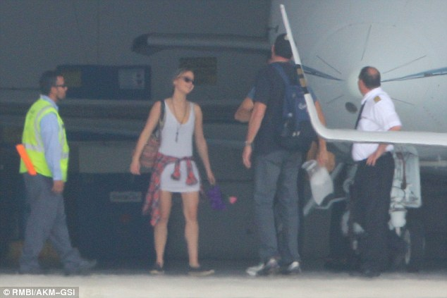 Jennifer Lawrence and Chris Martin Getting Off Jet Plane - Sept 22nd