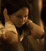 Jennifer Lawrence as Katniss Everdeen in Mockingjay Part 1